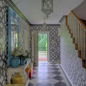 entrances/foyers - long entry, long foyer, long foyer ideas, long entry ideas, gray lantern, trellis wallpaper, gray trellis wallpaper, foyer wallpaper, wallpaper for foyers, foyer lanterns, entry lanterns, hall lanterns, gray crown molding, turquoise mirror, foyer mirror, foyer table, entry table, white foyer table, white entry table, turquoise planters, yellow bench, yellow tufted bench, black and white tiles, black and white floor, harlequin tiles, harlequin floor, black and white harlequin, black and white harlequin floor,