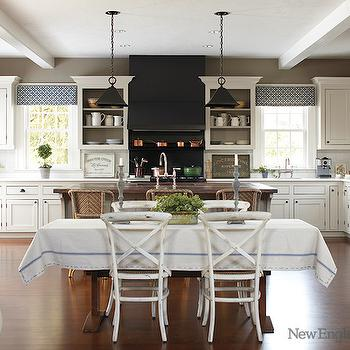 New England Home - kitchens - black and white kitchens, black kitchen hood, black range hood, black stove hood, black stove, black range, stove with double ovens, black cooktop backsplash, black stove backsplash, stove shelf, cooktop shelf, open cabinets, open kitchen cabinets, open display cabinets, painting interior of cabinets, open upper cabinets, open top cabinets, inset cabinets, inset kitchen cabinets, white marble countertop, copper pots, butcher block island, butcher block kitchen island, butcher block countertops, wood countertops, bistro barstools, kitchen valance, trestle dining table, whitewashed dining chairs, white cafe chairs,