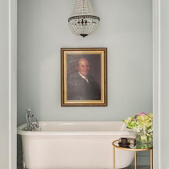 Sabbe Design - bathrooms: alcove, bathroom alcove, arched alcove, arched bathtub alcove, bathtub chandelier, tub chandelier, claw foot tub, claw foot bathtub, arched tub alcove, blue green walls, blue green bathroom walls, brass accent table, round brass accent table, mirrored top accent table, marble herringbone tiles, herringbone floor, marble herringbone floor,