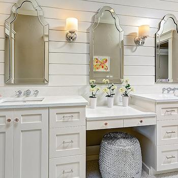 Clark and Co Homes - bathrooms: shiplap backsplash, shiplap paneling, shiplap paneled walls, off white sink vanity, off white shaker vanity, shaker front sink vanity, his and hers vanities, silver garden stool, woven silver garden stool, square undermount sink, wall mount hot and cold faucet, hot and cold faucet, speckled gray counter, arched mirror, arched frameless mirror, sink vanity with make up counter, drop down make up vanity, make up area in bathroom, bathroom dressing table, nickel cabinet pulls, crystal cabinet pulls, triplet bathroom, triplet bathroom ideas, shared bathroom, shared kids bathroom, shared kids bathroom ideas, silver rope stool, kids bathrooms, kids bathroom ideas, kids vanity,