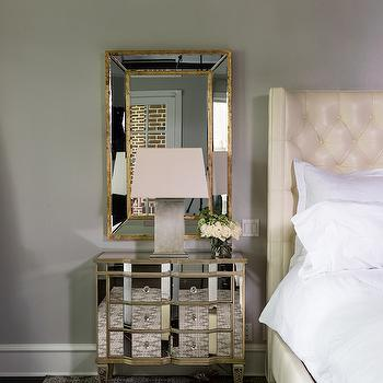 Paloma Contreras - bedrooms - mirror over nightstand, mirror above nightstand, gold trimmed mirror, gold leafed mirror, antiqued gold mirror, mirrored nightstand, gold mirrored nightstand, mirrored beside table, quartz table lamp, gray and white geometric rug, white bedding, white bed linens, ivory leather headboard, ivory leather tufted headboard, gray walls, gray wall color, cream leather bed, cream leather headboard, cream tufted bed, cream tufted headboard, mirror over nightstand,
