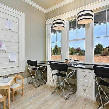 Clark and Co Homes - dens/libraries/offices - modern play table, modern kids table, steel directors chair, wall length built in desk, built in desk, black counter, triple sash window, black and white drum pendant, black striped drum pendant, homework room, homework room ideas, tongue and groove memo board, tongue and groove message board, gray walls, gray wall color, light hardwood floors, homework room, homework room ideas, drum pendants, striped drum pendants, black and white pendants, black and white light pendants, striped light pendants, desk for 3, built in desk, built in kids desks,