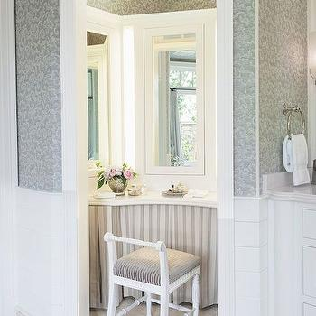 Luxe Interiors and Design - bathrooms - transom window over door, shiplap half wall, shiplap paneled half wall, shiplap bathroom paneling, patterned gray wallpaper, neutral tiled floor, skirted dressing table, striped skirted dressing table, white vanity chair, white stool with taupe seat, paneled vanity mirror, built in dressing table, built in dressing table mirror, dressing room in bathroom, make up vanity in bathroom, dressing table in bathroom, paneled bathroom, skirted vanity, skirted make up vanity, skirted make up table, vanity nook, make up vanity nook, dressing table nook, dressing room nook, striped floors,