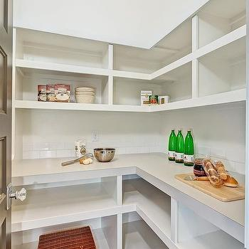 Clark and Co Homes - kitchens: L shaped pantry, pantry shelving, pantry built ins, subway tile, white subway tile, wraparound pantry built ins, walk in pantry shelving, pantry storage, crystal door knob, walk in pantry shelves, walk in pantry shelving,