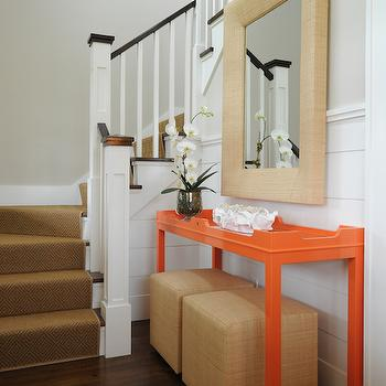 Nina Liddle Design - entrances/foyers - shiplap half wall, wood planked half wall, gray walls, gray wall color, sisal stair runner, sisal staircase runner, modern orange console table, lacquered orange console table, rafia pouf, square rafia ottoman, rafia wrapped mirror, rafia wall mirror, wraparound stairs, wraparound staircase, square newel post, raffia cubes, rafia cube ottomans, orange table, orange console table, orange lacquer table, orange lacquered table, raffia mirror, foyer table, entry table,