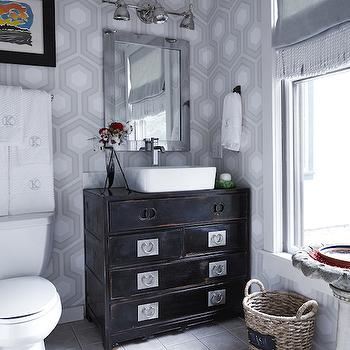 Lonny Magazine - bathrooms - gray geometric wallpaper, gray hex wallpaper, gray hexagonal wallpaper, retro gray wallpaper, gray tiled floors, gray ceramic floor tile, seagrass basket, black zen sink vanity, black asian sink vanity, asian dresser sink vanity, rectangular basin sink, basin sink, counter mount faucet, antiqued mirror, rectangular antiqued mirror, polished nickel vanity light, three light polished nickel vanity light, monogrammed towels, monogrammed bath towels, gray roman shade, gray window shade, hex wallpaper, hexagon wallpaper, gray hexagon wallpaper, repurposed vanity, repurposed washstand, chinese vanity, chinese washstand,