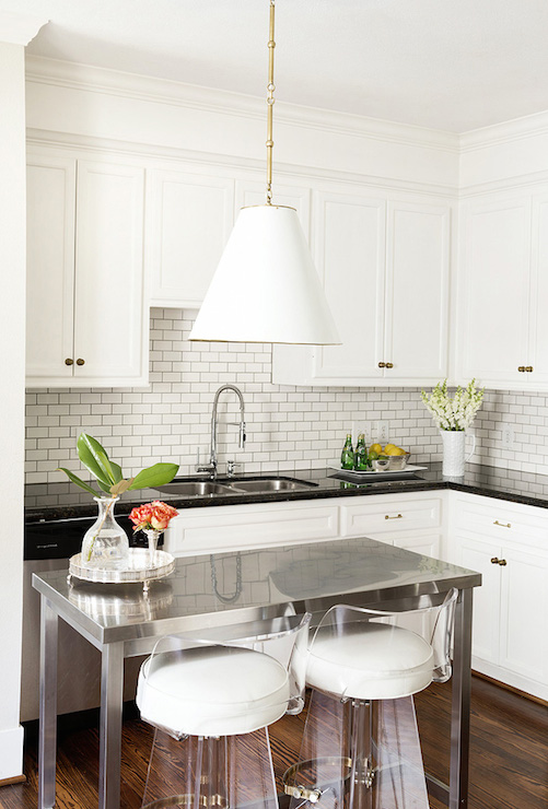 Hallie Henley Design - kitchens - Goodman Hanging Lamp, shaker cabinets, shaker kitchen cabinets, polished countertops, black countertops, polished black countertops, mini subway tiles, mini subway tiled backsplash, dual bowl sink, cabinets over sink, cabinets over kitchen sink, over the sink cabinets, above the sink cabinets, kitchen island, center island, stainless steel island, stainless steel kitchen island, lucite barstools, lucite counter stools, L shaped kitchen, kitchen island lighting,