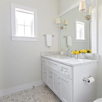 Hallie Henley Design - bathrooms - cream walls, cream bathroom walls, sconces on mirror, vanity mirrors, parsons mirror, white parsons mirror, parsons vanity mirror, white and grey marble, white vanity, carrera hex tiles, carrera hex floor, carrera marble hex tiles,