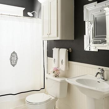 Hallie Henley Design - bathrooms - black and white bath, black and white bathroom, black and white shower curtain, monogram shower curtain, monogrammed shower curtain, black and white monogram shower curtain, black and white monogrammed shower curtain, cabinet over toilet, over the toilet cabinet, above the toilet cabinet, black walls, black bathroom walls, half painted walls, half painted bathroom walls, beadboard walls, half beadboard walls, bathroom beadboard, beadboard bathroom, art deco mirror, pedestal sink, vintage hex floor,