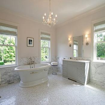 bathrooms - master bath, master bath ideas, master bathroom ideas, half painted walls, half tiled walls, marble wainscoting, tiled wainscoting, bathroom chandeliers, gray roman shades, gray linen roman shades, freestanding bathtub, oval bathtub, lucite accent table, mosaic marble tiles, mosaic marble floor, face to face washstands, face to face vanities, vanities facing each other, washstands facing each other, white marble countertop, polished nickel mirror, nickel vanity mirror, bathroom sconces, bathtub between windows,