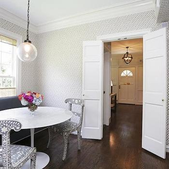 HAR - dining rooms - bi fold doors, dining room doors, bi fold dining room doors, dining room bi fold doors, dining room wallpaper, white and gray wallpaper, trellis wallpaper, gray trellis wallpaper, gray bench, gray dining bench, oval dining table, marble top dining table, bone inlay chairs,