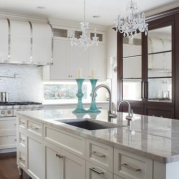 Gorgeous kitchen features lit cabinets stacked over white upper cabinets and white ...