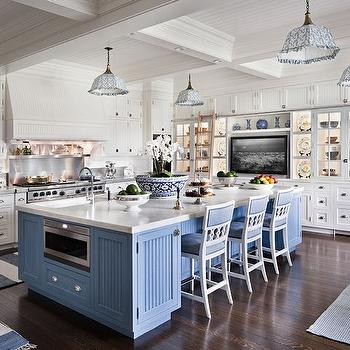 White and blue kitchen features beadboard, coffered ceiling dotted with white and ...
