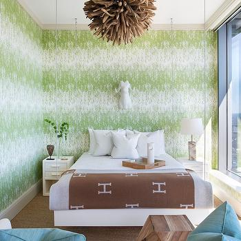 Atlanta Homes & Lifestyles - bedrooms: white and green wallpaper, hanging bed, suspended bed, wood chandelier, hermes blankets, brown hermes blanket, 2 drawer nightstand, white nightstand, bedroom sofa, white sofa, turquoise pillows,