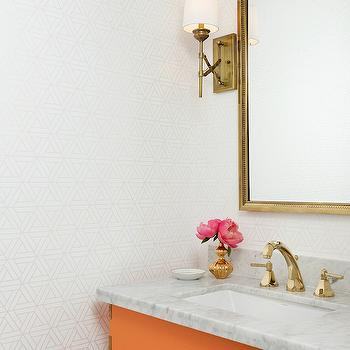 Hallie Henley Design - bathrooms - white and orange powder rooms, powder rooms, geometric wallpaper, white and gray wallpaper, white and gray geometric wallpaper, powder room wallpaper, wallpaper for powder rooms, brass mirror, vanity mirror, brass vanity mirror, brass sconces, powder room sconces, x sconce, brass x sconce, orange vanity, orange sink vanity, orange washstand, campaign vanity, orange campaign vanity, campaign style vanity, orange campaign washstand, brass faucets,