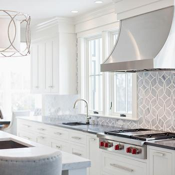 Stunning white and gray kitchen with shaker cabinets accented with brushed nickel ...