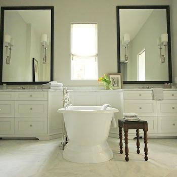 Elle Scrase - bathrooms - modern country bath, modern country bathrooms, black vanity mirrors, his and her washstands, his and her sink vanities, his and her vanities, sconces on mirrors, dresser like washstand, chest like washstand, chest washstand, dresser washstand, marble countertop, freestanding bathtub, rustic bench, country bench, bathroom bench, bench in bathroom, marble floor,