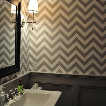 Deepdale House - bathrooms - gray chevron wallpaper, chevron wallpaper, powder room chevron wallpaper, powder room wallpaper, half wall wainscoting, gray wainscoting, powder room wainscoting, rectangular washstand sink, pedestal washstand sink, black mirror, black vanity mirror, contemporary polished nickel sconce, polished nickel sconce with white shade, gray and white powder room, wallpaper for powder rooms, gray wainscoting, powder room paneling, black lacquer mirror, gray powder room, white and gray powder room, martyn lawrence bullard wallpaper, fez wallpaper,