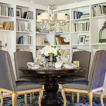 Martha O'Hara Interiors - dining rooms: dining room built ins, built in dining room bookshelves, built in bookshelves, dining room bookshelves, dark stained pedestal dining table, turned pedestal dining table, blue dining chair, blue dining chair with nailhead trim, cabriole leg dining chair, blue floral rug, silver leaf chandelier, small silver leafed chandelier, bookshelf styling, bookshelf styling ideas, dining room bookcase, dining room bookshelf, dining room built in bookcase, cabriolet leg dining chairs, dining chair cabriolet leg, dining room library, library dining room,