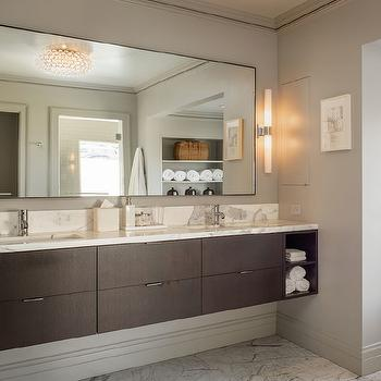 Sutro Architects - bathrooms - Benjamin Moore - Platinum Gray - marble floor tile, taupe bathroom walls, taupe wall color, floating bathroom vanity, floating dual sink vanity, flat front floating vanity, finger pull cabinet hardware, marble vanity counter, dual sinks, his and hers sinks, modern faucet, polished chrome faucet, bathroom baseboards, wall length floating vanity, wall length vanity mirror, floating vanity mirror, tubular wall sconce, frosted glass tubular wall sconce, coffee stained floating vanity, dark stained floating vanity, veneer vanity, veneer double vanity, taupe paint colors, floating double washstand, floating double vanity, chocolate brown veneer vanity, veneer vanity, veneer washstand,