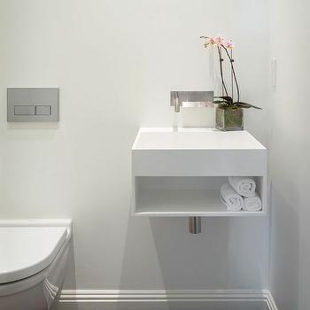 Sutro Architects - bathrooms - modern powder room, minimalist powder room, modern white powder room, wall mount toilet, modern toilet, toilet with wall flush, floating white vanity, floating white sink, modern sink vanity with shelf, modern sink with built in shelf, modern trough sink, wall mount faucet, modern wall mount faucet, wall faucet, minimalist wall faucet, , wall mounted sink vanity, wall mounted washstand,