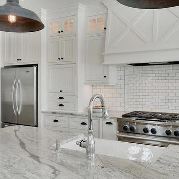 Gorgeous kitchen features stainless steel french door refrigerator to the left of ...