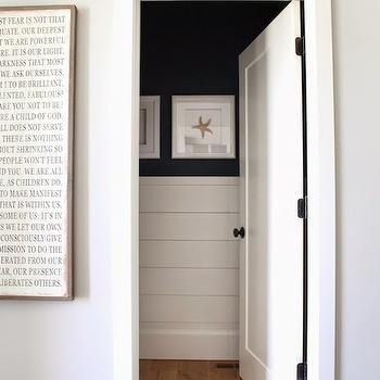 6th Street Design School - entrances/foyers - Benjamin Moore - Gray Owl - starfish wall art, shiplap half wall, wood planked half wall, navy blue walls, navy wall color, wood paneled half wall, starfish framed art, gray walls, gray wall color, sayings wall art, quote wall art, wide planked hardwood floors, paneled powder room, white and navy powder room, cottage powder room, half paneled walls, tongue and groove powder room, powder room tongue and groove, powder room paneling,