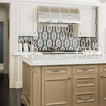 Stunning kitchen features a camel colored kitchen island accented with fluted trim ...