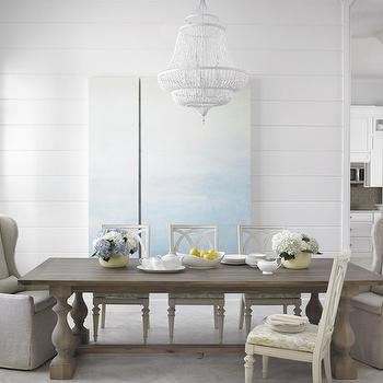 Krista Watterworth Design Studio - dining rooms - shiplap clad walls, horizontal wood paneling, wood planked wall, watery blue art, water abstract art, white beaded chandelier, glossy white beaded chandelier, belgian linen slipcovered dining chair, slipcovered wingback dining armchair, slipcovered end chairs, ivory lattice back dining chair, ivory geometric back dining chair, balustrade dining table, balustrade trestle dining table, gray wash trestle dining table, paneled dining room, dining room wall panels, linen dining chairs, linen wingback dining chairs, linen captain dining chairs, linen slipcovered dining chairs, slipcovered captain chairs, wingback captain chairs, salvaged wood dining table, reclaimed wood dining table,
