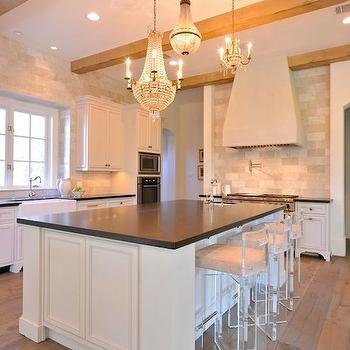 This kitchen detailed look features white cabinets that contrast nicely with the ...