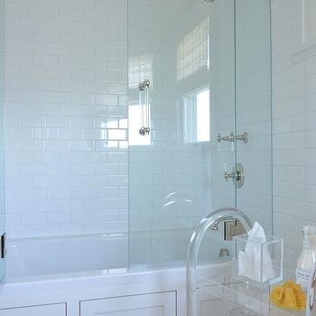 Munger Interiors - bathrooms - wainscoted drop in tub, seamless glass shower partition, subway tile shower surround, lucite bath cart, white bathroom, white subway tile, transparent bath cart, wainscoted bathtub, bathtub wainscoting, lucite cart, subway shower tiles, bathroom subway tiles,