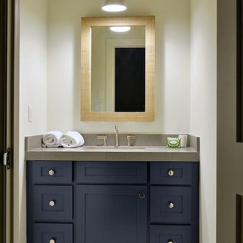 Munger Interiors - bathrooms: west elm wall mirror, navy washstand, gray quartz countertops, navy striped rug, lIbrary wall light, bathroom wall light, bathroom rug, striped bathroom rug, dark colored washstand, white and navy rug, navy blue washstand, navy sink vanity, navy blue sink vanity, navy blue vanity, bathroom sconces, navy striped rug, navy striped bath mat, grasscloth mirror, cottage bathroom, navy and gray bathroom,
