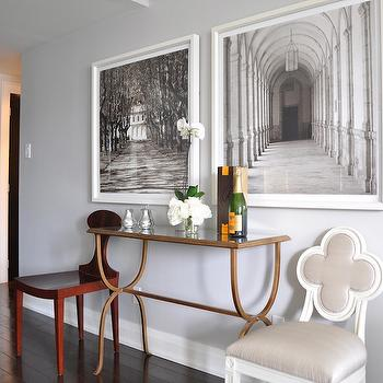 Meredith Heron Design - entrances/foyers - brass and glass console table, alexandra chair, wall art, art piece, artwork, photographed art piece, white framed art piece, white framed chair, console table, foyer table, foyer console table, quatrefoil char, foyer art, sepia art prints,