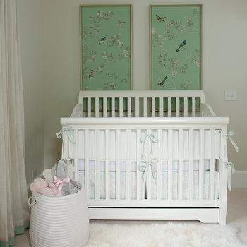 Liz Carroll Interiors - nurseries - traditional white crib, white hamper, white linen curtains, mint green and pink ribbon trim, chinoiserie fabric art panels, nursery artwork, white linen curtains, tree branches and birds art, green fabric art, circular white hamper, nursery hamper, over the crib art, art over the crib, curtain trim, drapery trim, chinoiserie art panels, nursery art, nursery curtains, nursery drapes, chinoiserie art panels, fabric art, fabric art panels,