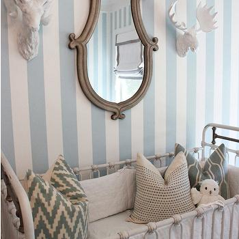 Lindsey Regan Thorne - nurseries: restoration hardware kennedy iron crib, white iron crib, white and blue striped wallpaper, white and blue nursery, linen crib bedding, white linen crib bedding, west elm pillows, z gallerie moose head and ram head, nursery wall mounted animal decor, hanging wall decor sculpture, hanging wall animal decor sculpture, brown mirror, brown framed mirror,