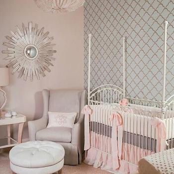 Summer House Style - nurseries: blue arabesque wallpaper, nursery accent wall, pastel nursery, white four poster crib, pink and gray crib bedding, gray wingback glider, round tufted ottoman, wood sunburst mirror, white beaded chandelier, thick pink ribbon bow, white tufted ottoman, beaded chandelier, wallpaper accent nursery wall, blue and brown wallpaper, accent wall, accent wall nursery, wallpapered accent wall, french crib, french nursery crib, french 4 poster crib, white nursery crib, gray nursery glider, nursery ottoman, round tufted ottoman, nursery mirrors, nursery chandeliers,