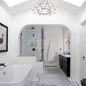 JWT Associates - bathrooms - bathroom archway, bathroom pony wall, carrara marble hex floor tile, hex bathroom floor tile, espresso sink vanity, louvered sink vanity, arched vanity alcove, seamless glass front shower, subway tiled shower surround, oiled bronze shower set, oil rubbed bronze rainfall shower head, ceiling mount shower head, oiled bronze wall mount faucet, modern freestanding tub, freestanding bathtub, black swan wall art, bathroom skylights, vaulted bathroom ceiling, vaulted ceiling with skylights, chandelier with glass shades, bathroom chandelier, archway, archway bathroom, pony wall, pony wall bathroom, arched bathroom alcove, subway shower tiles, vaulted ceiling with skylights, skylights on vaulted ceiling, bathroom chandeliers, bathroom partitions, Schoolhouse Electric Orbit Chandelier,