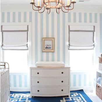 Lindsey Regan Thorne - nurseries - white and gray grosgrain roman shades, adele chandelier, chest as changing table, three drawer chest, striped wallpaper, blue and white nursery, white nursery chest, chest changing table, bow front chest, nursery chest, nursery dresser, bow front dresser, grosgrain roman shades, white and gray roman shades, nursery chandeliers, dresser changing table, bow front changing table, bow front dresser, white and blue striped wallpaper, nursery wallpaper, vertical stripe wallpaper, striped wallpaper, vertical striped nursery wallpaper, white and blue striped wallpaper, metallic striped wallpaper, nursery wallpaper, striped nursery wallpaper, blue greek key rug, greek key rug, white and blue nursery, boy nursery, boy nursery ideas, nursery roman shades, nursery window treatments, Alameda Rug,