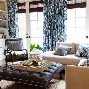Hillary Thomas - living rooms - french doors, wall of french doors, blue dragon print fabric, blue chinese dragon drapes, blue dragon pillow, linen sectional, striped blue pillow, black spindle chair, white bamileke table, tufted gray ottoman, tufted gray velvet ottoman, gray ottoman with nailhead trim, coffee table ottoman, sisal rug, blue dragon curtains, chiang mai dragon curtains, fireplace built ins, fireplace shelves, fireplace cabinets, white fireplace, black marble fireplace surround, dark woven shades, nesting trays, living room french doors, blue print curtains, layered window treatments, ottoman coffee table, gray ottoman coffee table, gray tufted ottoman, fireplace bookshelves, , Chiang Mai Dragon China Blue,