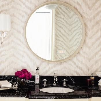 Hillary Thomas - bathrooms: oval vanity mirror, oval ivory mirror, scalloped wall sconce, wall sconce with scalloped shade, zebra print wallpaper, neutral zebra print wallpaper, black marble counter, round porcelain sink, hook spout sink faucet, ivory sink vanity, zebra powder room wallpaper, zebra wallpaper, cream zebra wallpaper, kenneth james wallpaper, bathroom wallpaper, wallpaper for bathrooms, barbara barry sconces, black marble countertops, ivory vanity, ivory washstand, ivory vanity black marble countertop, tribal wallpaper, cream tribal wallpaper,