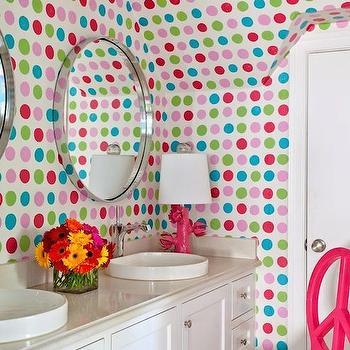 Tobi Fairley - bathrooms - kids bathrooms, kids bathroom ideas, colorful kids bathroom, polka dot walls, bathroom polka dots, hand painted polka dots, polka dot kids bathroom, hand painted walls, shared kids bathrooms, round vanity mirrors, metal vanity mirrors, round metal mirrors, metal convex mirrors, convex vanity mirrors, hot pink lamp, hot pink flower lamp, wall to wall vanity, wall to wall sink vanity, kids vanity, built in sink vanity, cream countertops, peace chair, hot pink chair, hot pink peace chair,