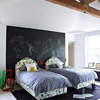 boy's rooms - chalkboard headboard wall, chalkboard paint headboard wall, chalkboard paint accent wall, chalkboard paint, arched parrot print headboard, parakeet print bed, gray bedding, parrot print upholstered bed, gray bed linens, twin bedroom, twin boys room, twin bedroom ideas, white painted floors, white hardwood floors, charcoal gray rug, rug under bed, beds on rug, red kids chair, rustic ceiling beam, wooden ceiling beams, chalkboard accent wall, kids chalkboard wall, parrot beds, parrot print beds, kids beds, kids rooms, kids bedrooms, white plank floors,