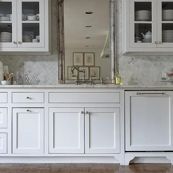 Lisa Luby Ryan - kitchens - white shaker cabinets, flush front kitchen cabinets, mirror behind sink, cabinet paneled dishwasher, hidden dishwasher, round nickel cabinet pulls, gray and white marble countertop, diamond laid marble tile, bridge hook spout faucet, silver leafed antique mirror, glass front upper cabinets, make a small kitchen look bigger, visually expand a small kitchen, marble tiled backsplash, gray and white marble backsplash, paneled fridge, paneled freezer drawers, concealed fridge, mirrored behind kitchen sink, kitchen sink mirror, french country kitchens, glass door kitchen cabinets, kitchen backsplash ideas, concealed dishwasher, hidden dishwashers, backsplash in diamond pattern diamond pattern backsplash,