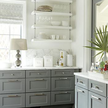 White and gray kitchen features gray ceiling over gray base cabinets topped with ...