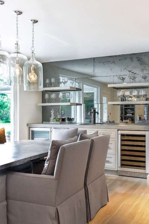 Antiqued Mirrored Backsplash Transitional Dining Room