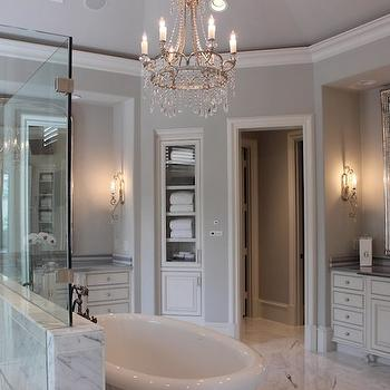 Talbot Cooley Interiors - bathrooms: french bath, french bath ideas, french bathroom ideas, washstand nook, bathroom nook, vanity nook, gray french bathrooms, antique white vanity, antique white sink vanity, antique white washstand, striped marble, striped marble countertops, striped gray marble, gray striped marble, gray striped marble countertops, silver arch mirror, silver leaf vanity mirror, arched vanity mirror, french sconces, pot lighting, bathroom alcove, sink alcove, washstand alcove, walk in shower, glass and marble shower, chandelier over bathtub, silver leaf mirror, silver leaf vanity mirror, white and grey bathrooms, white and gray master bathrooms, corner linen cabinet, inset linen cabinet, recessed linen cabinet, glass front linen cabinet, built in linen cabinet, round bathrooms, round master bathrooms, circular bathrooms, circular master bathrooms,