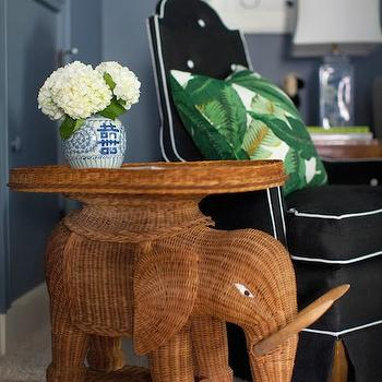 Furbish Studio - living rooms - steel blue walls, steel blue living room walls, elephant table, wicker table, wicker elephant table, rattan elephant table, ming vase, black chair, black tufted chair, button tufted chair, black and white chair, black chair with white piping, palm window, palm leaf pillow,