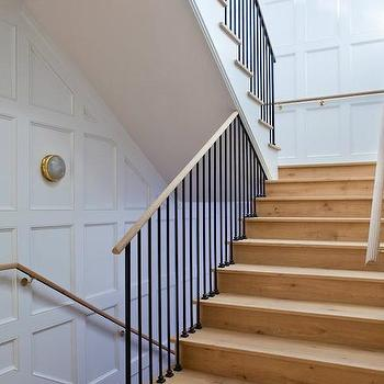 Studio William Hefner - entrances/foyers - wood staircase, iron balusters, wood hand rail, wood staircase rail, full wall wainscoting, floor to ceiling wainscoting, stairwell wainscoting, staircase wainscoting,