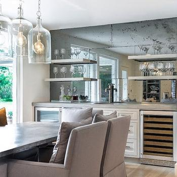 Talbot Cooley Interiors - dining rooms - wet bar, wet bar ideas, dining room bar, dining room wet bar, wet bar dining room, antiqued mirrored tiles, antiqued mirrored backsplash, zing shelves, floating shelves, zinc floating shelves, wet bar shelves, wet bar shelving, wet bar sink, zinc countertops, mini fridge, glass front mini fridge, glass door mini fridge, glass front wine cooler, zinc dining table, zinc top dining table, gray dining chairs, slipcovered dining chairs, gray slipcovered dining chairs, dining room pendants, dining room light pendants,