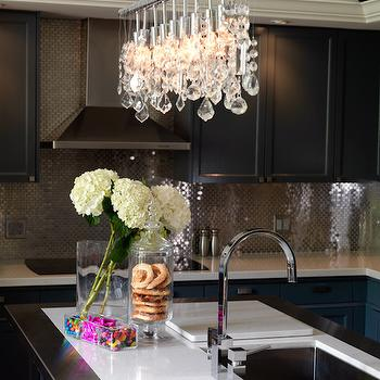 Emily Griffin Design - kitchens - crystal chandelier, kitchen crystal chandelier, kitchen island chandelier, white quartz countertops, stainless steel kitchen island, modern gooseneck faucet, black cabinets, black kitchen cabinets, stainless steel tiles, stainless steel tile backsplash,